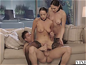 two subs on leashes writhe on a huge manstick