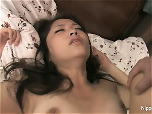 asian schoolgirl gets pummeled on the bed