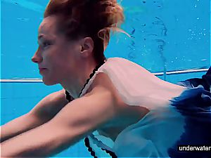teenager lady Avenna is swimming in the pool