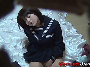 Uniformed japanese stunner caresses
