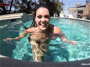 bodacious Alison swims and strokes in the pool