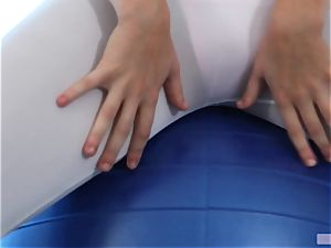 Alexis Adams drills across a gym ball