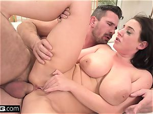 Angela deep-throats her own bosoms as she's pummeled in the backside