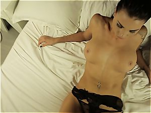 Alluring temptress performing a steamy dance half nude