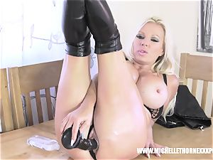 Oily blonde biker stunner masturbates with a enormous dark-hued plaything
