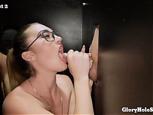 Kat Monroe blows penises at gloryhole