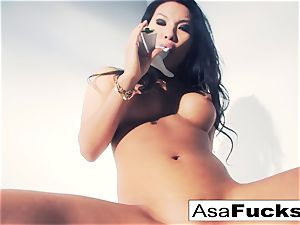 Asa Akira uses a faux forearm to sate her cunt