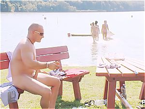 fortunate dude having a fine time at the lake pt trio