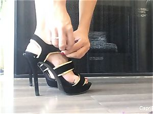 Capri flashes off her beautiful feet & attempts on some stilettos