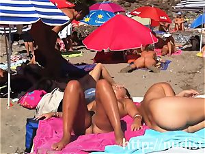 cool nudist ladies in natures attire on the beach